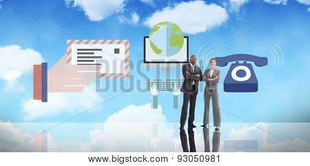 Confident business team against bright blue sky