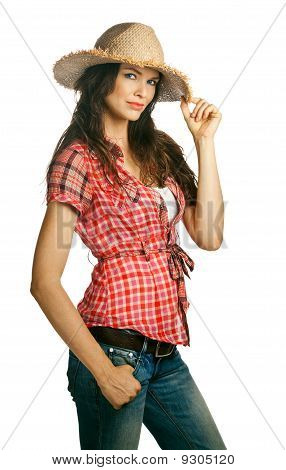 Portrait Of A Beautiful Young Cowgirl With Attitude