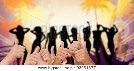 Hands giving thumbs up against digitally generated nightlife background with people dancing
