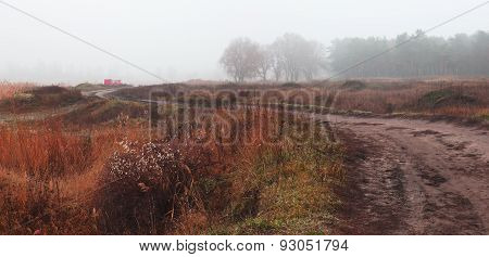 Autumn Foggy Landscape With Village Road