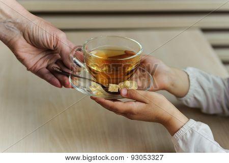Cup Of Tea In The Children's Hands