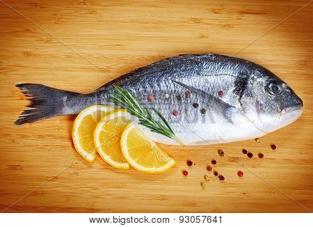 Fresh Fish Dorado On Wooden Background