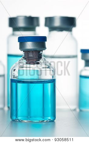 Vials Of The Vaccine, Blue Background