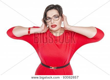 Plus Size Woman In Glasses Covering Her Ears With Her Hands