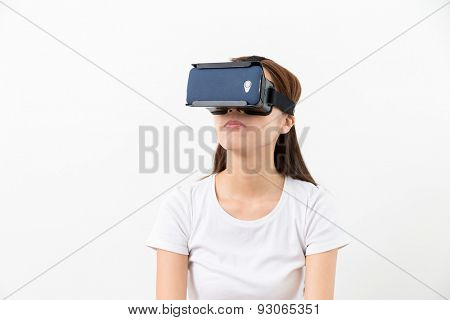 Young woman experience virtual reality on a mobile phone