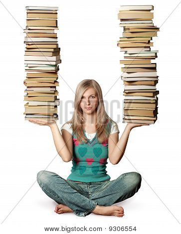 Woman In Lotus Pose With Many Books In Her Hands