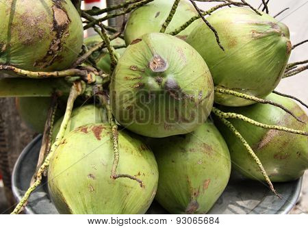 Green coconut at the market
