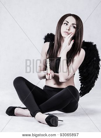 Beautiful Young Woman In A Costume Of The Dark Angel