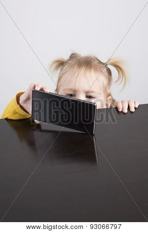 Baby Watching Phone On Table