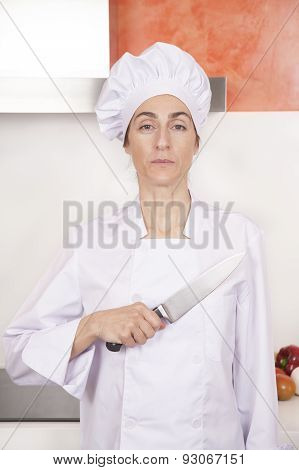 Proud Woman Chef Saluting Knife On Chest