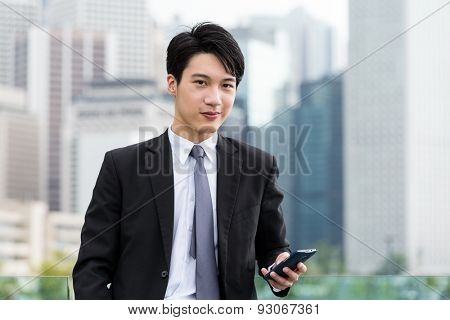 Young businessman use of smart phone