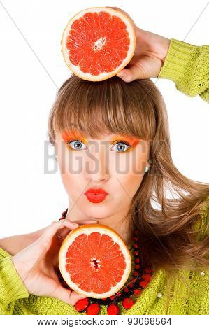 Cute Young Woman With Two Grapefruits
