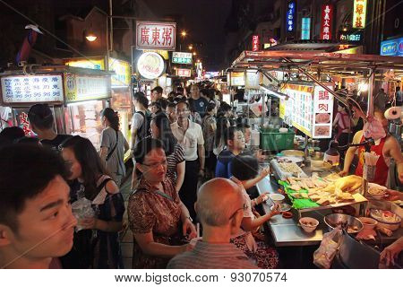Taipei, Taiwan - May 15th 2015: Shilin Night Market a popular destination for tourists and locals.  Endless food stalls and crowds.