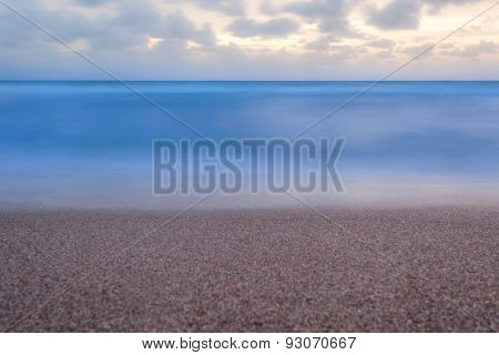 Minimalist Placid Blue Ocean Scene At Sunrise.