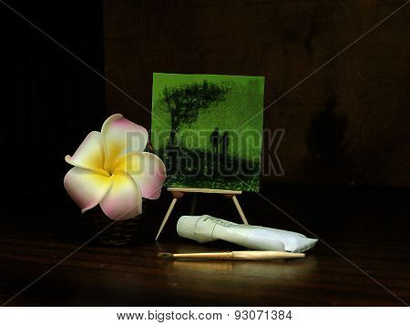 Small picture, painting supplies and flower