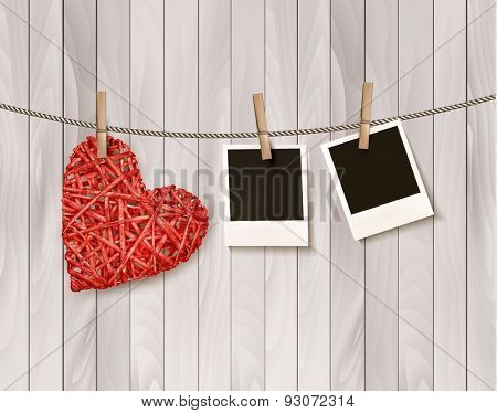 Red wooden heart with photographs. Vector.