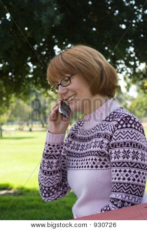 Woman Talking On Cell At Park