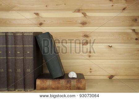 Front view of old book stacked on a shelf. Book without title and author.