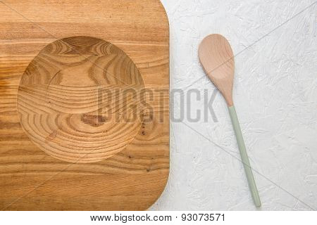 Decorated Wooden Spoon & Chopping Board On White Surface