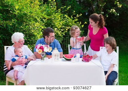 Big Family Having Lunch Outdoors