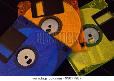 Three Floppy Disks Against Black Background
