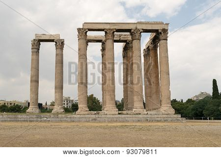 Columns of the temple of zeus against a blue sky.