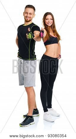 Athletic Man And Woman After Fitness Exercise With Thumbs Up On The White