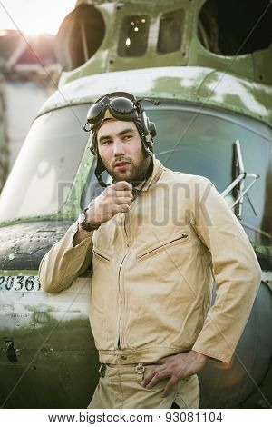 Young Pilot Posing Near The Helicopter
