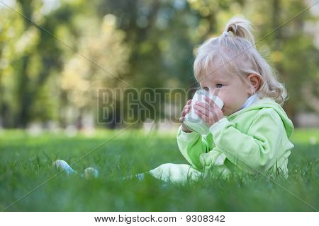 Serious Little Girl Drinking Milk