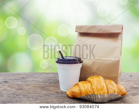 Coffee And Croissant With Paper Bag For Breakfast