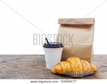 Coffee And Croissant With Paper Bag
