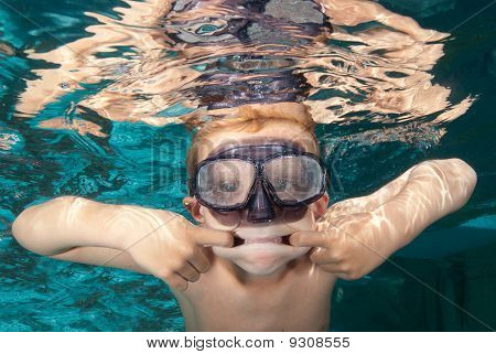 Boy Swimming And Making A Face