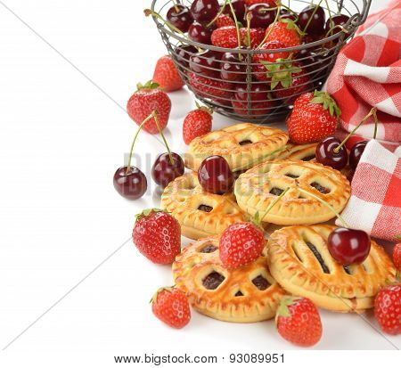 Mini Cakes With Strawberry And Cherry On A White Background