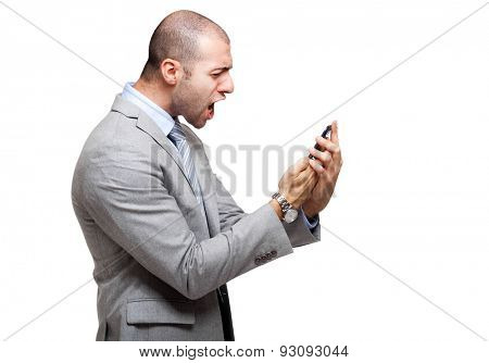 Angry man screaming at his phone