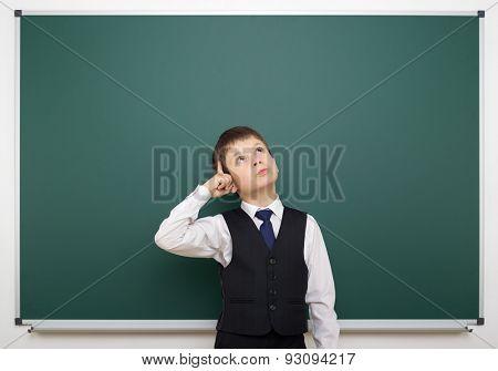 Schoolboy near the school board