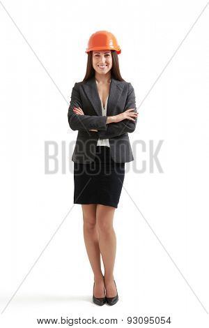 full-length portrait of smiley woman in formal wear and orange hardhat. isolated on white background