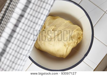 Bread dough is being prepared before baked