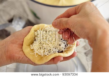 Filling bread dough with grated cheese