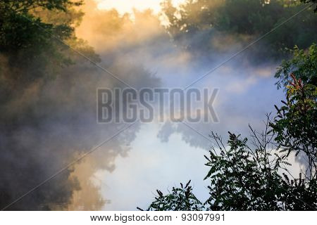 Landscape with morning mist over river