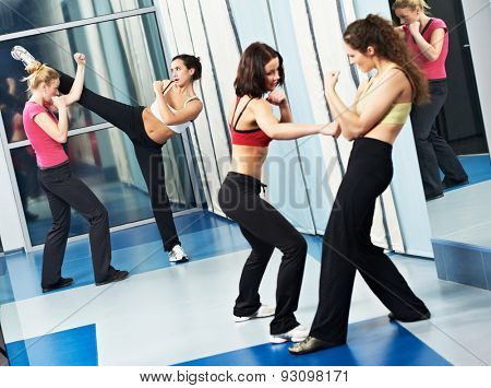 group of woman at fitness gym during martial art fighting physical training excercises thai bo