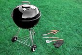 image of tong  - BBQ Appliance On The Lawn With Grill Tools On The Backyard Or Park Grass - JPG
