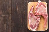 image of pork chop  - Fresh pork chops or cutlets on wooden background - JPG