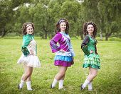 picture of wig  - Three young beautiful girls in irish dance dress and wig posing outdoor