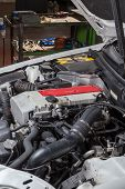 pic of muscle-car  - car with the hood open in repair workshop - JPG