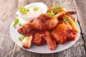 pic of fried chicken  - fried chicken leg with french fries and sauce - JPG