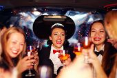 foto of hen party  - group of happy elegant women clinking glasses in limousine hen party  - JPG