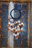 pic of dream-catcher  - Dream Catcher and ornamental window on background - JPG