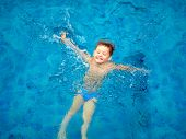 picture of wallow  - cute kid boy swimming in pool water top view - JPG