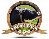stock photo of cow head  - Wooden round icon or symbol with head of cow text fresh milk and three daisy flowers - JPG