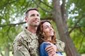 picture of reunited  - Handsome soldier reunited with partner on a sunny day - JPG